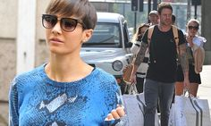 Wayne Bridge carries wife Frankie's bags after Harvey Nichols spree