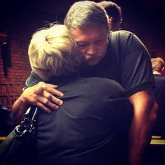 Jacobus Steyn aka Bonnie Steyn (pilot) at his bail hearing hugging his wife. He is said to be part of the Ras Syndicate group in the role of pilot to transport poachers and packages of horn. Crime In South Africa, Rhino Poaching, Horn, Documentaries, Pilot, African, Group, Horns, Pilots