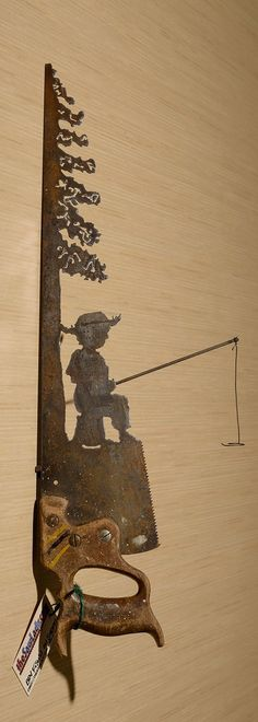 Metal Art Rustic plasma cut Young Boy Fishing near a tree hand saw wall decor - Made to Order plasma cut metal art, hand made | Wall art. These saws are a great, unique gift for friend or yourself! Perfect for the fisherman in your life! Also available with a little boy or girl fishing - check my other listings! THIS IS A MADE TO ORDER PRODUCT I may be able to get this out to you faster than listed here- contact me to check my current schedule. You can also add your initials (or up to 4...