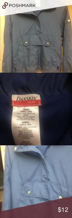 Windbreaker blue size 4/6 Nice pullover windbreaker by Danskin. Has large poker across the front. A very soft fabric. Last pic shows color the truest. In EUC with no tears or stains Danskin Now Tops Sweatshirts & Hoodies
