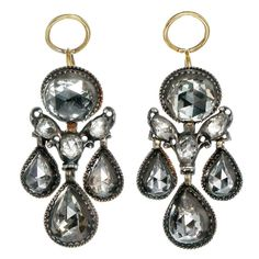 Dutch Rose Cut Diamond Earrings. Dutch rose cut diamond earrings, in silver on 18k gold. 14 high domed rose cut diamonds. The foil backing of the diamonds are bright and lively in all settings. Circa 1740, Dutch in origin.