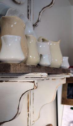 Unfinished wood shelf brackets with weathered paint treatment