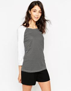 Top by Vero Moda Soft-touch, lightly textured fabroc Round neckline Geometric panels Raglan sleeves in ponte fabric Zip fastening to the reverse Regular fit - true to size Machine wash 89% Polyester, 6% Viscose, 5% Elastane Our model wears a UK S/EU S/US XS
