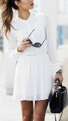 white out outfit with white pleated skirt and white blouse
