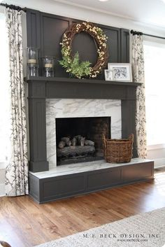 A painted fireplace -example of it being built off the floor