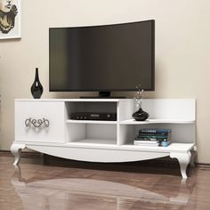 Televisions have come a long way from the small black boxes which displayed moving black and white images. Get a TV Unit like our SULTAN White TV Unit for only $285.81!  Tags: #doseofmodern #movie #Movies #moviestar #MovieNight #moviequotes #movietime #moviemaking #movieposter #movielover #movieset #moviefacts #moviebuff #MovieDay #moviemaker #moviereview #moviequote #MovieDirector #movienews #moviedate #MovieStars #movietheater #moviescene #moviemagic #MOVIEART #MovieAddict #moviecollection Timeless Design, Modern Design, White Tv Unit, Tv Unit Furniture, Tv Unit Design, Black N White Images, About Time Movie, Particle Board, Living Spaces