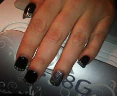 Black shellac with silver glitter on acrylic nails.
