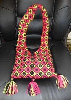 Hand bag with the use of star stitch pink and lime wool and mirror embroidery.