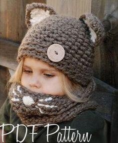 Тёплая шапка с ушками для девочки вяжется крупной вязкой крючком. В комплекте с шапочкой можно связать и снуд такого же цвета.