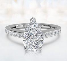 Such a sparkly single pear shaped diamond engagement ring
