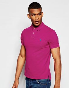 "Polo shirt by Polo Ralph Lauren Breathable cotton pique Ribbed collar and cuffs Two button placket Embroidered polo player Uneven vented hem Slim fit - cut closely to the body Machine wash 100% Cotton Our model wears a size Medium and is 188cm/6'2"" tall"