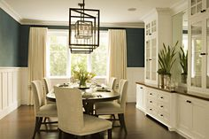 I love the white chair rail (I think that's what it's called) beneath the dark (teal) color of the upper wall. The crown molding is gorgeous, and the cabinetry is pretty, too. Wouldn't it be neat if the cabinet shelves went through to the kitchen? Then you could set the table without running back and forth...