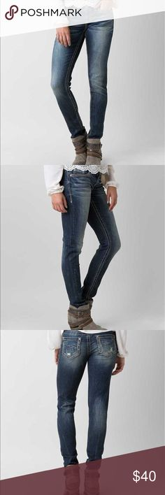 "Daytrip Lynx Skinny Jean 27S * Stock photos taken from Buckle website. *  Reasonable offers welcome. 20% off bundles!  • Excellent condition.  BUCKLE EXCLUSIVE! -- Inseam 28"" Rise 7.5"" -- • Style SBK1400/Skus 119327, 119328 • Mid-rise zip fly stretch jean • Slightly fitted through the hip, thigh and leg • 11"" bottom opening • Metallic embroidery on pieced back pockets • Hand sanding, whiskering and veining details • Model Info: Height: 5'8"" 