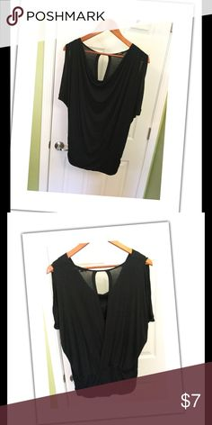 Pretty Shirt This black top can be worn with a skirt to dress up or shorts and jeans for a casual look. Back has a slit to the bottom. Part of of your shoulders show. Size M Storm Tops Blouses