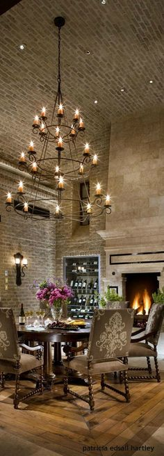 Love the high brick ceilings, the multiple types of mood lighting including the fireplace in the dining area! Dining Room Lighting, Dining Room Decor, Rustic House, Decor, Rustic Dining Room, High Ceiling Lighting, Rustic Lighting, Modern Lamp Design Inspiration, Rustic Dining