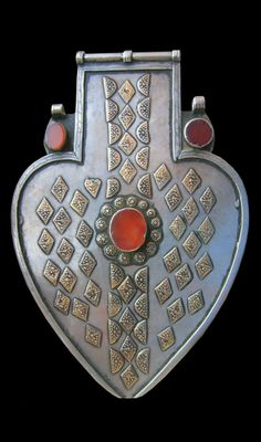 Central Asia | large Turkoman / Turkmen silver pendant ~ Asyk ~ with gold applique and carnelian inset. | Late 19th Century | Yomud tribe | Sold