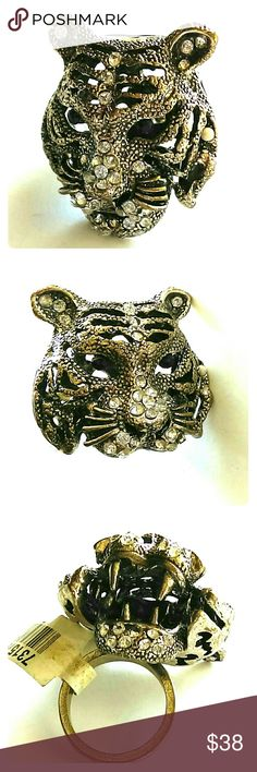 Growl! Tiger ring  - hinged mouth * it moves! BNWT Love tigers? Wear one on your finger with a hinged movable mouth that opens and closes! This is a brand new with tags antique silver with a copper-ish patina ring. Inset rhinestones and Jet stones for eyes. Size 7. I have two of these. This is an incredible ring; no one else is going to have anything like this. Jewelry Rings