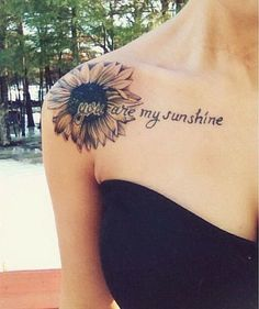 """Sunflower Shoulder Tattoo with the script """"You are my sunshine""""."""