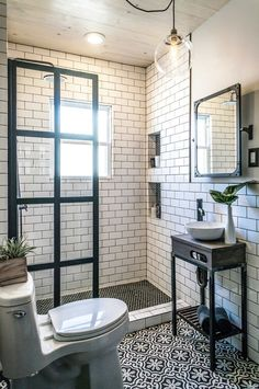Cottage Life. Black and White bathroom simple elegant timeless. Plants add life