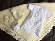 May 2017, a selection of items that make up our baby Bereavement Packs, made by our wonderful volunteers to ensure every UK Angel Baby has the chance to be dressed in a gorgeous Angel gown, with accompanying blanket, nappy, hat and bootees. All gowns made from a UK donated wedding dress.