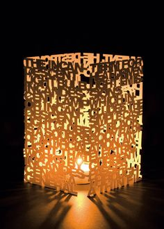 Typo Lamp PROJECT BY: László Sándor Made of Card paper and cut out as one peice.