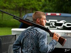 OMG - This is allowed in a HIGH SCHOOL! Dustin Langenberg of Bertrand, Neb. poses with a gun and a Ford truck.