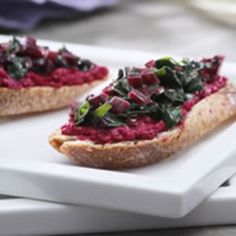 Check out this recipe on Better Eats Roasted Beet Crostini. Beets are roasted then pureed with goat cheese for  a spread. The greens & stems are sauteed with olive oil & garlic for the topping.