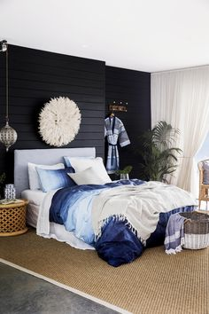 The coastal style calls for natural materials such as timber and wicker. Here, a 'Marmara' towel in Midnight Blue spills out of a 'Wicker' hamper, while a wooden 'Basic' wall hook displays a cotton 'Tieppo' kimono robe. Wicker Hamper, Style Challenge, Guest Rooms, Coastal Style, Vw Bus, Bed & Bath, Natural Materials, Midnight Blue, Interior Inspiration