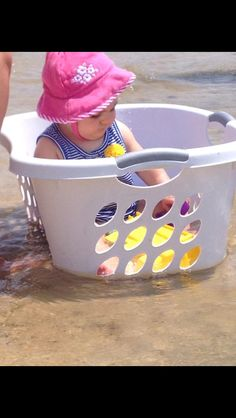 Pinned said: Saw this idea for bath tub but thought it was great for the beach. Put baby in a laundry basket with toys (tons of sunscreen and adult supervision please) and place in the shallow waves on the beach. Last beach trip, she ate all the sand, this time she can only dip her toys in the water and stay cool in the gentle waves. It was a huge success!