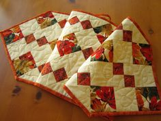 Quilted Table Runner Handmade Home Decor Orange Red and Gold Leaves by patchworkmountain.com