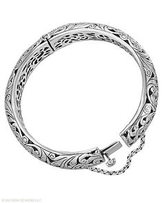 """Get lost in the filigree of wildflowers with this floral hinged Sterling Silver Bangle Bracelet. Interior diameter measures 2 1/2"""" with a Box Clasp and a Safety Chain."""