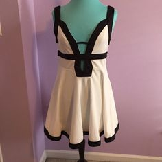 Ultra sexy Black and White skater dress above the knee... ploy elastin blend... plunging neck line and back. Dresses Mini
