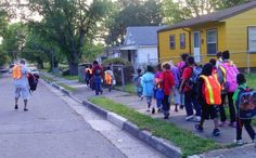 Special to the News Sentinel Volunteer Melvin Kyle, left, leads a group of students participating in the walking school bus program at Lonsdale Elementary. Therapy, Students, Walking, Street View, Community, Group, News, School, Walks