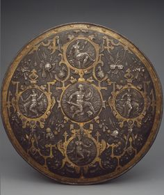 Pageant Shield. Place of creation: Italy. Date: Second half of the 16th century. Material: steel. Technique: chased and gilded.