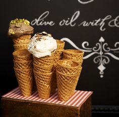 Waffle cones in stand. Nice blackboard background