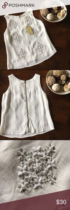 White Beaded Blouse New with tags white Freeway blouse with beautiful beaded pattern. Zipper closure down center of back. Purchased from Dillard's. Never worn except for posh photo model. No flaws. Smoke free home. No trades please. Freeway Tops Blouses