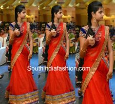 Tomato red lehenga and voni paired up with contrast blue thread work and mirror work designer high neck blouse.