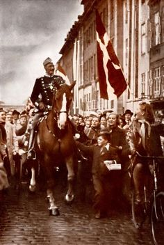 "King Christian X of Denmark. Unlike other monarchs, the King decided to stay in his capital throughout WW2.  During the Nazi occupation, the King's daily ride through Copenhagen became a symbol of Danish sovereignty. This picture was taken on his birthday in 1940. He was not accompanied by a guard. One apocryphal story relates that, a German soldier remarked to a boy that he found it odd that the king would ride with no bodyguard. The boy replied, ""All of Denmark is his bodyguard""."