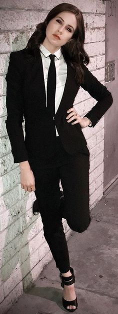 9130c9af2cc Girl Dressed Formal In Black Pants Suit With White Shirt And Black Tie