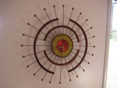 MCM Wall Clock. This is the one that I recently bought! Mine needs some TLC -- repaint the brass spokes and replace the clock guts.