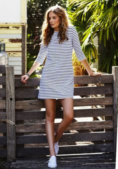 striped dress with sneakers... Not crazy about thin dizzy stripes but drawn to the dress type/shape with those shoes.