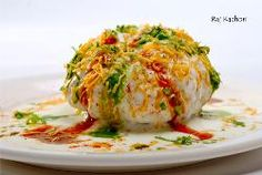 Rajasthani Shahi Raj-Kachori, stuffed katchori with potato and sprout filling and served with curd, chutney and sev.