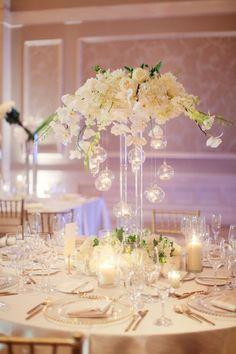 photographer: Binary Flips Photography; white flower wedding reception centerpiece idea