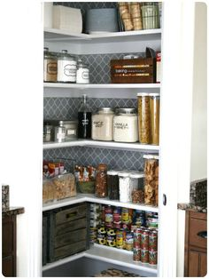 20 Perfect Pantry Ideas  I like the wallpaper behind the shelves look