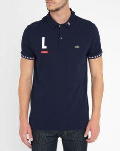 2b2934835456 Polo bleu manches courtes liseré rouge Londres LACOSTE