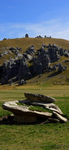 NZ, Castle Hill - This is a popular place for rock climbers and was also used for the filming of Lord of the Rings and then Chronicles of Narnia. It's about an hour from Christchurch and difficult to miss. You would suddenly see some weird rock formations jutting out from the green fields. After parking it's a short walk to see the rocky outcrops.