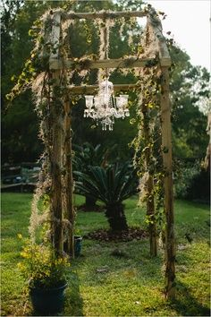 Without the chandelier... mossy? Simple construction... aged wood. I think there's a way to fake that look of age...