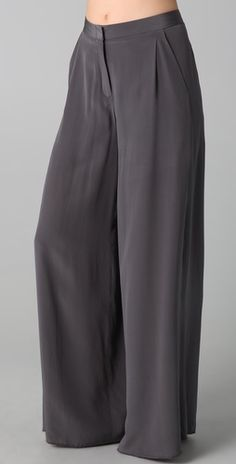 "Wide leg pants: slant hip pockets and a hook-and-eye closure. Serged cuffs. Lined. 12"" rise - 34"" inseam- 33"" leg opening- Fabrication: Silk crepe- 100% silk."