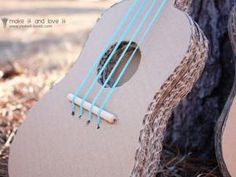 My husband plays the guitar, banjo and violin, and any time he picks up one of his instruments, the kids always seem to want to play along. Diy For Kids, Cool Kids, Crafts For Kids, Diy Crafts, Banjo, Violin, Ukulele, Cardboard Guitar, Cardboard Crafts