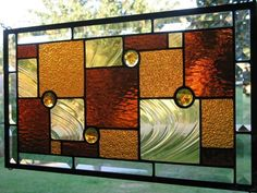 Up for sale is a beautiful ~Amber Stunner~ stained glass window panel.  This panel is absolutely beautiful. This beautiful geometric piece features stunning ambers and clear glass.  The piece is made